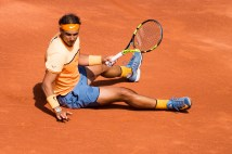 Rafael Nadal lays on the ground during his match against Marcel Granollers during day three of the Barcelona Open Banc Sabadell at the Real Club de Tenis Barcelona on April 20, 2016 in Barcelona, Spain. (April 19, 2016 - Source: Alex Caparros/Getty Images Europe)