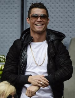 Real Madrid's Portuguese forward Cristiano Ronaldo smiles as he attends the Madrid Open tournament at the Caja Magica (Magic Box) sports complex between Spanish tennis player Rafael Nadal and Portuguese tennis player Joao Sousa in Madrid on May 6, 2016..Rafael Nadal will face defending champion Andy Murray in the Madrid Masters semi-finals after extending his perfect start to the European clay-court season to 13 matches with a 6-0, 4-6, 6-3 win over Joao Sousa today... / AFP / JAVIER SORIANO (May 5, 2016 - Source: AFP)