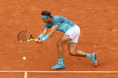PARIS, FRANCE - MAY 24: Rafael Nadal of Spain hits a backhand during the Men's Singles first round match against Sam Groth of Australia on day three of the 2016 French Open at Roland Garros on May 24, 2016 in Paris, France. (Photo by Dennis Grombkowski/Getty Images)