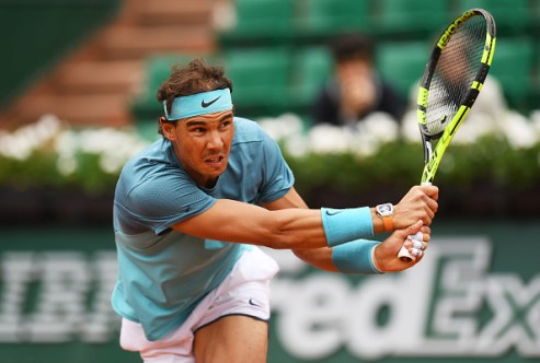PARIS, FRANCE - MAY 24: Rafael Nadal of Spain plays a backhand during the Men's Singles first round match against Sam Groth of Australia on day three of the 2016 French Open at Roland Garros on May 24, 2016 in Paris, France. (Photo by Dennis Grombkowski/Getty Images)