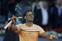 Rafael Nadal, from Spain, celebrates after winning his match against Sam Querrey, from US, during the Madrid Open tennis tournament in Madrid, Spain, Thursday, May 5, 2016. Nadal won 6-4 and 6-2. (AP Photo/Francisco Seco)