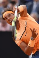 ROME, ITALY - MAY 12: Rafael Nadal of Spain serves in his match against Nick Kyrgios of Australia on Day Five of The Internazionali BNL d'Italia on May 12, 2016 in Rome, Italy. (Photo by Dennis Grombkowski/Getty Images)