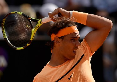 ROME, ITALY - MAY 12: Rafael Nadal of Spain plays a forehand in his match against Nick Kyrgios of Australia on Day Five of The Internazionali BNL d'Italia on May 12, 2016 in Rome, Italy. (Photo by Dennis Grombkowski/Getty Images)