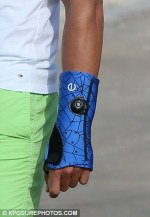 Rafael Nadal wears a bright blue wrist support on holiday