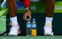 2016 Rio Olympics - Tennis - Preliminary - Men's Singles Third Round - Olympic Tennis Centre - Rio de Janeiro, Brazil - 11/08/2016. Rafael Nadal (ESP) of Spain lines up his water bottles during his match against Gilles Simon (FRA) of France. REUTERS/Toby Melville FOR EDITORIAL USE ONLY. NOT FOR SALE FOR MARKETING OR ADVERTISING CAMPAIGNS.