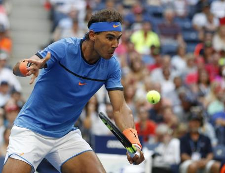 Rafael Nadal, of Spain, returns a shot to Lucas Pouille, of France, during the fourth round of the U.S. Open tennis tournament, Sunday, Sept. 4, 2016, in New York. (AP Photo/Alex Brandon)