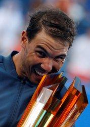 Tennis - Mubadala World Tennis Championship - Rafael Nadal of Spain v David Goffin of Belgium - Abu Dhabi, UAE - 31/12/16 - Rafael Nadal of Spain poses with his trophy. REUTERS/Ahmed Jadallah