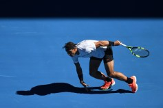 Spain's Rafael Nadal loses his balance as he runs for a return against Russia's Alexander Zverev during their men's singles third round match on day six of the Australian Open tennis tournament in Melbourne on January 21, 2017. / AFP / SAEED KHAN / IMAGE RESTRICTED TO EDITORIAL USE - STRICTLY NO COMMERCIAL USE (Jan. 20, 2017 - Source: AFP)