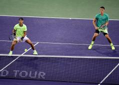 INDIAN WELLS, CA - MARCH 10: Rafael Nadal of Spain and Bernard Tomic of Australia watch a ball over the net as they play in the men's doubles against Pablo Carreno Busta of Spain and Joao Sousa of Portugal at Indian Wells Tennis Garden on March 10, 2017 in Indian Wells, California. (Photo by Harry How/Getty Images)