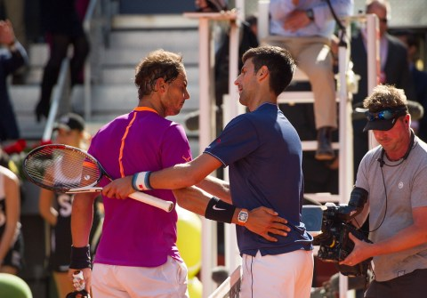 Rafael Nadal of Spain is congratulated by Novak Djokovic of Serbia after winning the semi-finals match during day eight of the Mutua Madrid Open tennis at La Caja Magica on May 13, 2017 in Madrid, Spain. (May 12, 2017 - Source: Denis Doyle/Getty Images Europe)