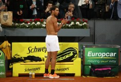 Nick Kyrgios of Australia leaves the court after his straight sets loss as Rafael Nadal of Spain applauds him off during day six of the Mutua Madrid Open tennis at La Caja Magica on May 11, 2017 in Madrid, Spain. (May 10, 2017 - Source: Julian Finney/Getty Images Europe)