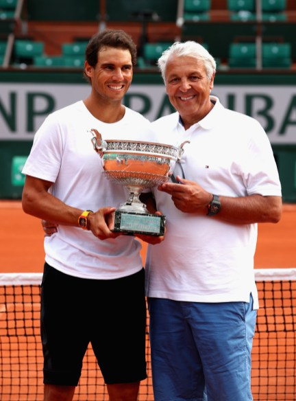 Rafael Nadal of Spain and his Dad, Sebastian Nadal, hold the winners trophy following the mens singals final match between Stan Wawrinka of Switzerland and Rafael Nadal of Spain on day fifteen of the 2017 French Open at Roland Garros on June 11, 2017 in Paris, France. (June 10, 2017 - Source: Clive Brunskill/Getty Images Europe)