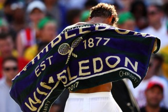 Rafael Nadal of Spain changes his shirt after the Gentlemen's Singles first round match against John Millman of Australia on day one of the Wimbledon Lawn Tennis Championships at the All England Lawn Tennis and Croquet Club on July 3, 2017 in London, England. (July 2, 2017 - Source: Michael Steele/Getty Images Europe)