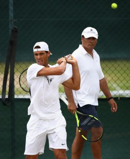 Rafael Nadal of Spain plays a backhand in a training session with coach and uncle Toni Nadal at Wimbledon on July 9, 2017 in London, England. (July 8, 2017 - Source: Julian Finney/Getty Images Europe)