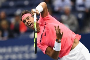 Spain's Rafael Nadal serves the ball to Russia's Andrey Rublev during their 2017 US Open Men's Singles Quarterfinal match at the USTA Billie Jean King National Tennis Center in New York on September 6, 2017. / AFP PHOTO / Jewel SAMAD