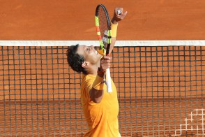 Rafael Nadal of Spain celebrates winning the men's single tennis match against Aljaz Bedene of Slovenia during the Monte-Carlo ATP Masters Series Tournament on April 18, 2018 in Monaco. / AFP PHOTO / VALERY HACHE (Photo credit should read VALERY HACHE/AFP/Getty Images)