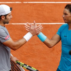 Spain's Rafael Nadal and Italy's Simone Bolelli she hands after their first round match of the French Open tennis tournament at the Roland Garros stadium in Paris, France, Tuesday, May 29, 2018. (AP Photo/Michel Euler)