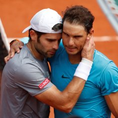 Tennis - French Open - Roland Garros, Paris, France - May 29, 2018 Spain's Rafael Nadal hugs Italy's Simone Bolelli after winning his first round match REUTERS/Christian Hartmann