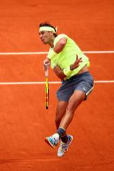 PARIS, FRANCE - JUNE 09: Rafael Nadal of Spain plays a smash during the mens singles final against Dominic Thiem of Austria during Day fifteen of the 2019 French Open at Roland Garros on June 09, 2019 in Paris, France. (Photo by Clive Brunskill/Getty Images)