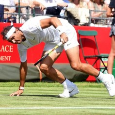 epa07680255 Spain's Rafael Nadal falls during his match against France's Lucas Pouille at the Aspall Classic tennis at the Hurlingham club in London, Britain, 28 June 2019. EPA-EFE/FACUNDO ARRIZABALAGA