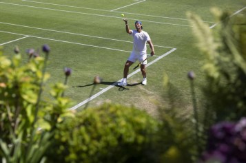 epa07677314 Rafael Nadal of Spain serves during a training session at the All England Lawn Tennis Championships in Wimbledon, London, on Thursday, June 27, 2019. EPA-EFE/PETER KLAUNZER EDITORIAL USE ONLY; NO SALES, NO ARCHIVES
