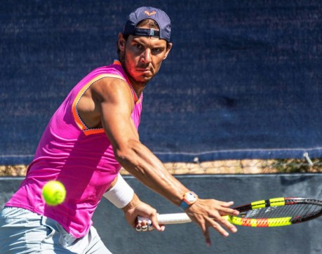 epa07655673 Spanish tennis player Rafael Nadal attends a training session at the Country Club in Santa Posa, Mallorca, Spain, 18 June 2019. Nadal prepares for the upcoming Wimbledon Championships. EPA-EFE/CATI CLADERA