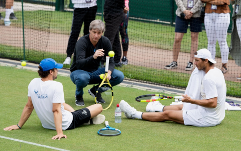 LONDON, ENGLAND - JULY 07: Rafael Nadal (R) of Spain takes a break in a practice session during Middle Sunday of The Championships - Wimbledon 2019 at All England Lawn Tennis and Croquet Club on July 07, 2019 in London, England. (Photo by Matthias Hangst/Getty Images)