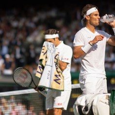 Roger Federer (SUI) & Rafael Nadal (ESP) in the semi-final of the Gentlemen's Singles on Centre Court. The Championships 2019. Held at The All England Lawn Tennis Club, Wimbledon. Day 11 Friday 12/07/2019. Credit: AELTC/Ben Solomon