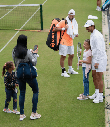 LONDON, ENGLAND - JULY 07: Rafael Nadal of Spain poses for a photo with a young fan after a practice session during Middle Sunday of The Championships - Wimbledon 2019 at All England Lawn Tennis and Croquet Club on July 07, 2019 in London, England. (Photo by Matthias Hangst/Getty Images)