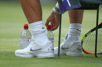 8th July 2019, The All England Lawn Tennis and Croquet Club, Wimbledon, England, Wimbledon Tennis Tournament, Day 7; Rafael Nadal lines up his water bottles during a break in his game versus Sousa (por) (photo by Shaun Brooks/Action Plus via Getty Images)