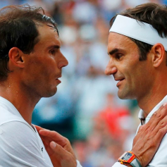 TOPSHOT - Switzerland's Roger Federer (R) shakes hands and embraces Spain's Rafael Nadal (L) after Federer won their men's singles semi-final match on day 11 of the 2019 Wimbledon Championships at The All England Lawn Tennis Club in Wimbledon, southwest London, on July 12, 2019. (Photo by Adrian DENNIS / POOL / AFP) / RESTRICTED TO EDITORIAL USE (Photo credit should read ADRIAN DENNIS/AFP/Getty Images)