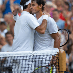 LONDON, ENGLAND - JULY 12: Roger Federer of Switzerland and Rafael Nadal of Spain embrace at the net after their semi final match on Day Eleven of The Championships - Wimbledon 2019 at All England Lawn Tennis and Croquet Club on July 12, 2019 in London, England. (Photo by Visionhaus/Getty Images)