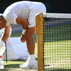 Spain's Rafael Nadal takes water as he plays Switzerland's Roger Federer during their men's singles semi-final match on day 11 of the 2019 Wimbledon Championships at The All England Lawn Tennis Club in Wimbledon, southwest London, on July 12, 2019. (Photo by Daniel LEAL-OLIVAS / AFP) / RESTRICTED TO EDITORIAL USE (Photo credit should read DANIEL LEAL-OLIVAS/AFP/Getty Images)