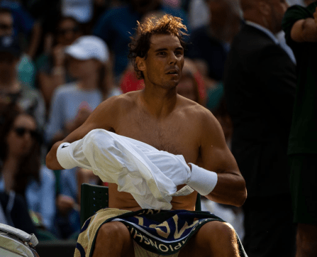 LONDON, ENGLAND - JULY 02: Rafael Nadal of Spain changes his shirt and headband at the end of the second set in his match against Yuichi Sugita of Japan during Day 2 of The Championships - Wimbledon 2019 at All England Lawn Tennis and Croquet Club on July 02, 2019 in London, England. (Photo by TPN/Getty Images)