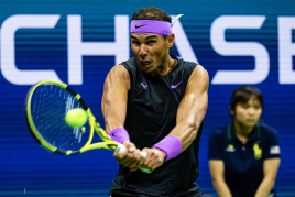 NEW YORK, NEW YORK - AUGUST 27: Rafael Nadal of Spain hits a backhand against John Millman of Australia in the first round of the US Open at the USTA Billie Jean King National Tennis Center on August 27, 2019 in New York City. (Photo by TPN/Getty Images)