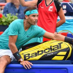 MONTREAL, QC - AUGUST 07: Rafael Nadal of Spain reaches over the bench during stoppage in his match against Daniel Evans of Great Britain on day 6 of the Rogers Cup at IGA Stadium on August 7, 2019 in Montreal, Quebec, Canada. (Photo by Minas Panagiotakis/Getty Images)