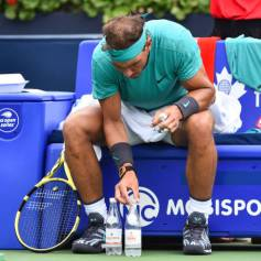 MONTREAL, QC - AUGUST 07: Rafael Nadal of Spain adjusts his water bottles during stoppage in his match against Daniel Evans of Great Britain on day 6 of the Rogers Cup at IGA Stadium on August 7, 2019 in Montreal, Quebec, Canada. (Photo by Minas Panagiotakis/Getty Images)