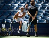 NEW YORK, NEW YORK - AUGUST 25: Rafael Nadal of Spain practices with coaches, Carlos Moya and Francisco Roig, on Arthur Ashe Stadium at the USTA Billie Jean King National Tennis Center on August 25, 2019 in New York City. (Photo by TPN/Getty Images)