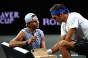 GENEVA, SWITZERLAND - SEPTEMBER 19: Rafael Nadal of Team Europe speaks with teammate Roger Federer during a practice session ahead of the Laver Cup 2019 at Palexpo on September 19, 2019 in Geneva, Switzerland. The Laver Cup will see six players from the rest of the World competing against their counterparts from Europe. Team World is captained by John McEnroe and Team Europe is captained by Bjorn Borg. The tournament runs from September 20-22. (Photo by Julian Finney/Getty Images for Laver Cup)