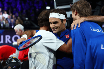 GENEVA, SWITZERLAND - SEPTEMBER 21: Roger Federer of Team Europe celebrates with teammates Rafael Nadal and Alexander Zverev after his singles match victory against Nick Kyrgios of Team World during Day Two of the Laver Cup 2019 at Palexpo on September 21, 2019 in Geneva, Switzerland. The Laver Cup will see six players from the rest of the World competing against their counterparts from Europe. Team World is captained by John McEnroe and Team Europe is captained by Bjorn Borg. The tournament runs from September 20-22. (Photo by Clive Brunskill/Getty Images for Laver Cup)