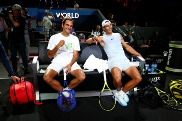GENEVA, SWITZERLAND - SEPTEMBER 18: Roger Federer of Team Europe and teammate Rafael Nadal react as they sit down during a practice session ahead of the Laver Cup 2019 at Palexpo, on September 18, 2019 in Geneva, Switzerland. (The Laver Cup consists of six players from the rest of the World competing against their counterparts from Europe. John McEnroe will captain the Rest of the World team and Europe will be captained by Bjorn Borg) The event runs from 20-22 Sept. (Photo by Clive Brunskill/Getty Images for Laver Cup)
