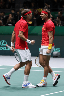 MADRID, SPAIN - NOVEMBER 23: Rafael Nadal of Spain and Feliciano Lopez of Spain celebrate after winning the first set in their semi-final doubles match against Jamie Murray and Neal Skupski of Great Britain during Day 6 of the 2019 Davis Cup at La Caja Magica on November 23, 2019 in Madrid, Spain. (Photo by Alex Pantling/Getty Images)