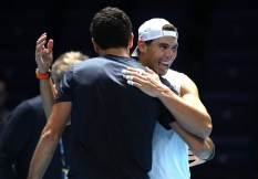 LONDON, ENGLAND - NOVEMBER 08: Rafael Nadal of Spain embraces Matteo Berrettini of Italy after their training session during previews for the Nitto ATP World Tour Finals at The O2 Arena on November 08, 2019 in London, England. (Photo by Alex Pantling/Getty Images)