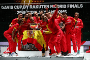 MADRID, SPAIN - NOVEMBER 24: Rafael Nadal of Spain takes a picture with the trophy and his teammates Marcel Granollers, Feliciano Lopez, Pablo Carreno Busta and Roberto Bautista Agut and the rest of their team following their victory over Canada during Day Seven of the 2019 Davis Cup at La Caja Magica on November 24, 2019 in Madrid, Spain. (Photo by Clive Brunskill/Getty Images)