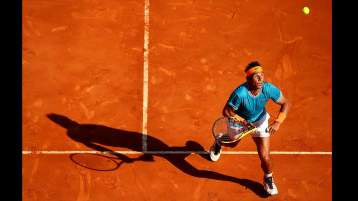"""Monte Carlo 2019: """"This is one of my favourites of 2019. It's very unusual to get this type of shot and in this light! Rafa was lobbed and he turned to sprint back looking up at the ball. I'm just glad I was on a short lense so that I managed to also get the shadow and ball in!"""" - Clive Brunskill"""
