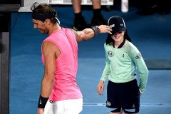 Spain's Rafael Nadal speaks with a ball kid who was hit by the ball during the men's singles match against Argentina's Federico Delbonis on day four of the Australian Open tennis tournament in Melbourne on January 23, 2020. (Photo by Manan VATSYAYANA / AFP) / IMAGE RESTRICTED TO EDITORIAL USE - STRICTLY NO COMMERCIAL USE (Photo by MANAN VATSYAYANA/AFP via Getty Images)