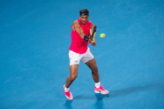 MELBOURNE, AUSTRALIA - JANUARY 29: Rafael Nadal of Spain plays a backhand in his quarter final match against Dominic Thiem of Austria on day ten of the 2020 Australian Open at Melbourne Park on January 29, 2020 in Melbourne, Australia. (Photo by TPN/Getty Images)