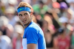 MONTREAL, ON - AUGUST 10: Rafael Nadal of Spain looks on during day one of the Rogers Cup at Uniprix Stadium in his doubles match against Tomas Berdych of the Czech Republic and Jack Sock of the USA on August 10, 2015 in Montreal, Quebec, Canada. (Photo by Minas Panagiotakis/Getty Images)