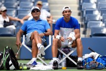 August 25, 2015 – Toni Nadal, left, and Rafael Nadal look on during practice for the 2015 US Open at the Billie Jean King National Tennis Center in Flushing, NY. - USTA/Steven Ryan