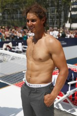 NEW YORK, NY - AUGUST 25: Rafael Nadal plays tennis at the Tommy Hilfiger and Rafael Nadal Global Brand Ambassadorship Launch at Bryant Park on August 25, 2015 in New York City. (Photo by Jeff Zelevansky/Getty Images for Tommy Hilfiger)